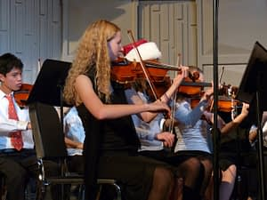 Elizabeth Mae films plays first chair violin in middle school orchestra